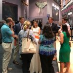 new faculty and professional staff gathering around table at networking event at florida museum