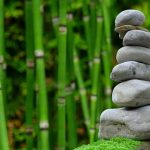 stock image of stacked stones and bamboo